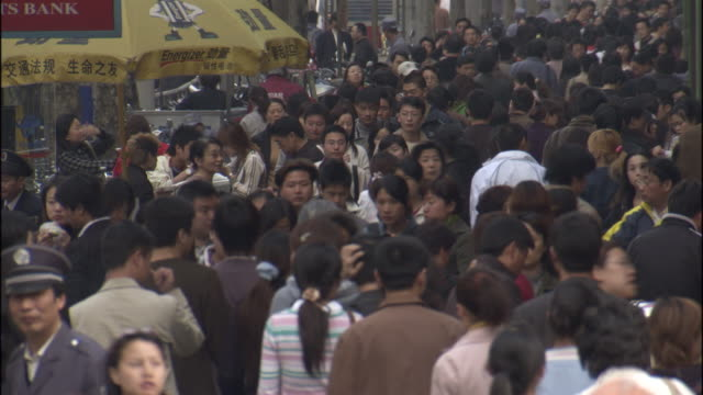 ms crowd walking down sidewalk/ defocus crowd/ shanghai, china - population explosion stock videos and b-roll footage