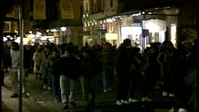 crowd walking down street at night during mardi gras in new orleans - gras stock videos and b-roll footage