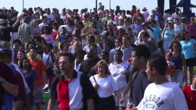 crowd walking forward on ramp - artbeats stock videos & royalty-free footage
