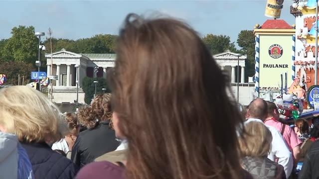 "ms crowd walking infront of statue of ""bavaria"" ,street on oktoberfest / munich, bavaria, germany - western script stock videos & royalty-free footage"