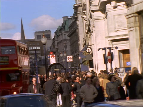 crowd walking on busy regent street in london - anno 1997 video stock e b–roll