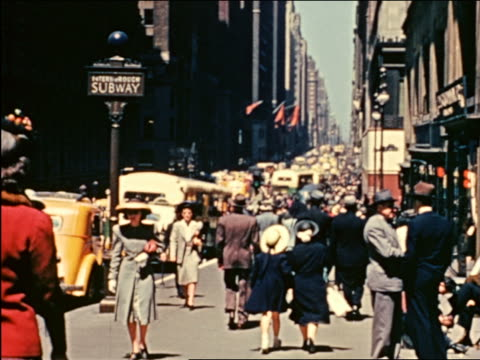 1941 crowd walking on fifth avenue, nyc / industrial - fifth avenue stock videos & royalty-free footage