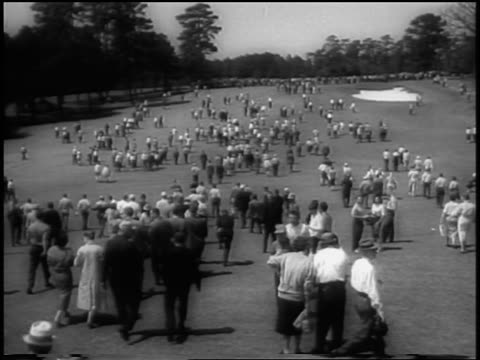 view crowd walking on golf course fairway following masters tournament / augusta ga - 1958 stock videos & royalty-free footage