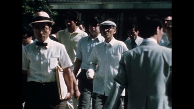 ms crowd walking on sidewalk in hiroshima, japan; 1975 - 1975 stock videos & royalty-free footage