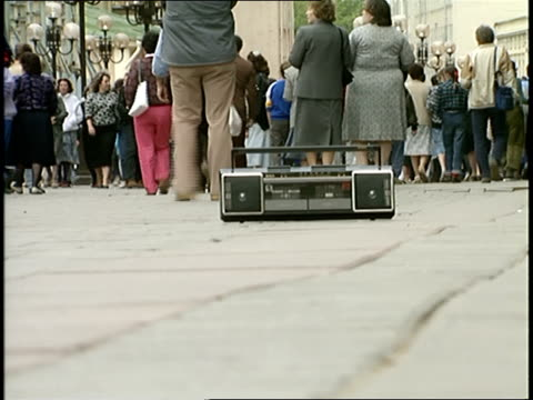 crowd walking past boombox on sidewalk in moscow - portable stereo stock videos & royalty-free footage