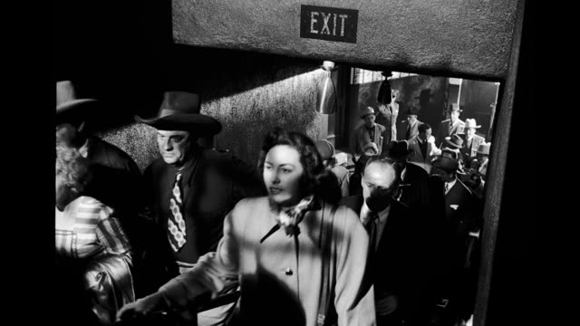 crowd walking up stairs under exit sign. crowd walking up stairs under exit sign on january 01, 1940 - exit sign stock videos & royalty-free footage