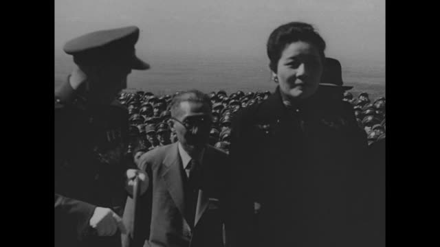 crowd walks along paved avenue leading to mausoleum / aerial sun yatsen's mausoleum on purple mountain wing of plane in foreground / general chiang... - chiang kai shek stock-videos und b-roll-filmmaterial
