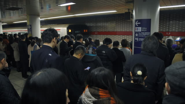 crowd walks to subway at rush hour - tokyo, japan - stazione della metropolitana video stock e b–roll
