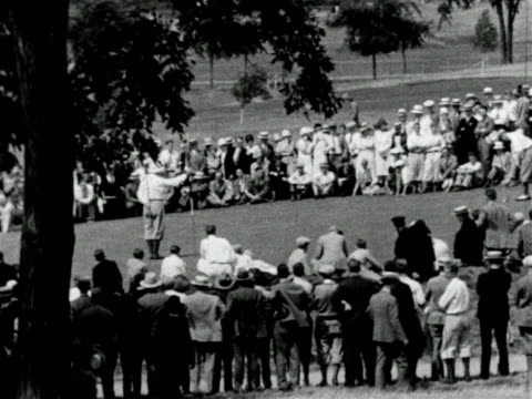 b/w 1927 crowd watches as ball comes towards hole in national amatuer golf championship / instruc - 1927 stock videos & royalty-free footage