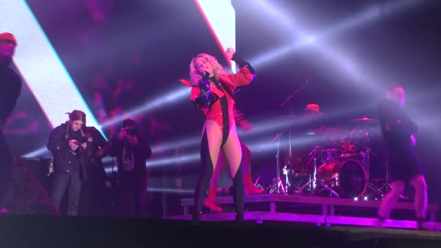 crowd watches as kosovo-born british singer rita ora performs on stage during an open-air concert on the occasion of the 10th anniversary of kosovo... - singer点の映像素材/bロール
