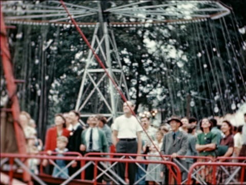 1946 crowd watches swinging amusement park ride at State Fair / industrial /AUDIO