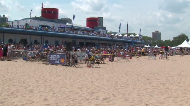 crowd watches the chicago air and water show on aug. 20, 2017. - chicago air and water show stock videos & royalty-free footage