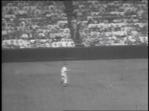 crowd watching game / elliot hits ball / left fielder runs for ball / gil hodges runs home / elliot runs bases to home - 1951 stock videos & royalty-free footage