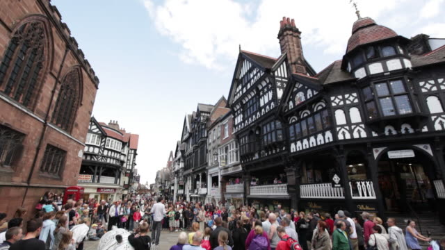 ms td crowd watching man's street performer / chester, england - human limb stock videos & royalty-free footage