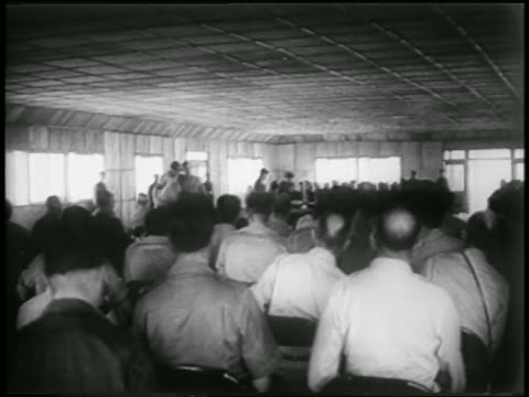 vidéos et rushes de view crowd watching signing of korean war armistice / panmunjom south korea - 1953