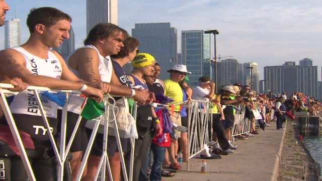 crowd watching swimming leg of the triathlon on august 27 2012 in chicago illinois - スキーウェア点の映像素材/bロール