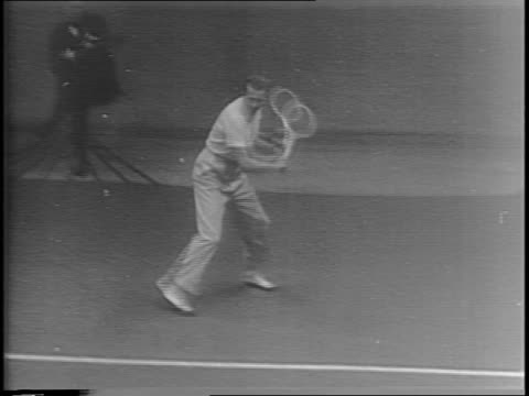 crowd watching tennis match / montage of donald budge and jack kramer playing tennis / soldiers in uniform watching moving their heads following the... - moving after stock videos & royalty-free footage
