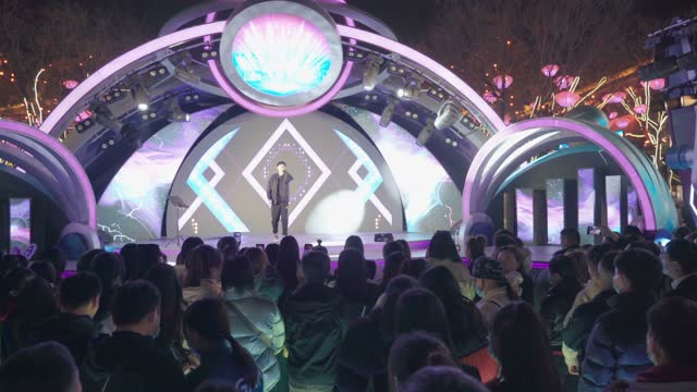 crowd watching the performance at scenic spot for celebrate chinese spring festival / xi'an, shaanxi, china - pop music stock videos & royalty-free footage