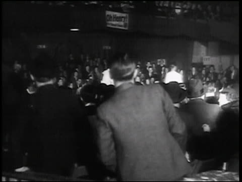 b/w 1938 rear view crowd watching walkathon / chicago / newsreel - newsreel stock videos and b-roll footage