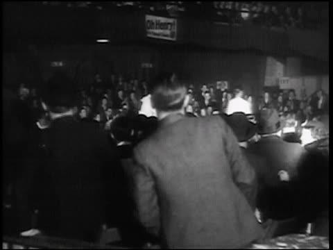 B/W 1938 REAR VIEW crowd watching walkathon / Chicago / newsreel
