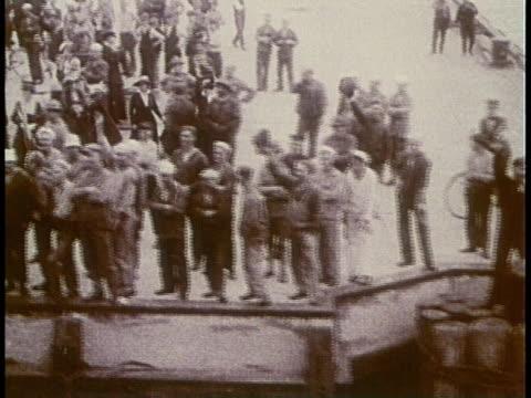 POV crowd waving farewell to departing ship / United States