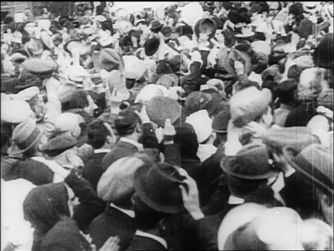 vídeos y material grabado en eventos de stock de view crowd waving hats at rally / russia / documentary - 1917