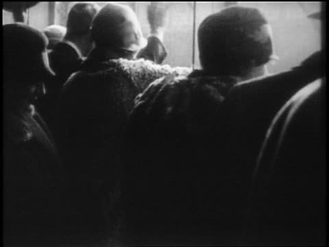 b/w 1928 rear view crowd waving / newsreel - 1928 stock-videos und b-roll-filmmaterial