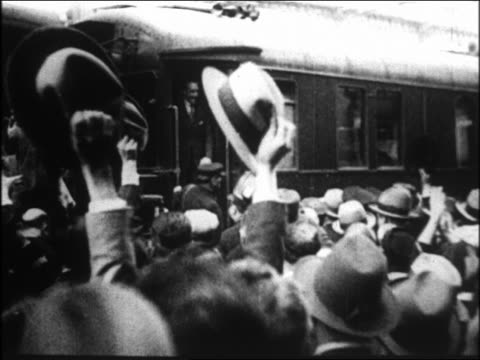 B/W 1931 crowd waving to King Alfonso XIII on train pulling away / Spain