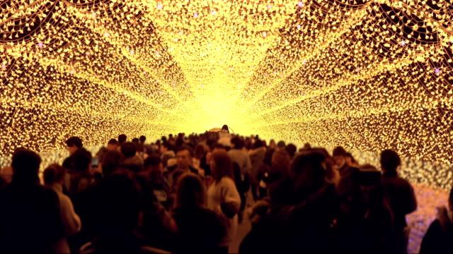 crowd with big yellow light illumination at night in winter Nagoya, Japan.
