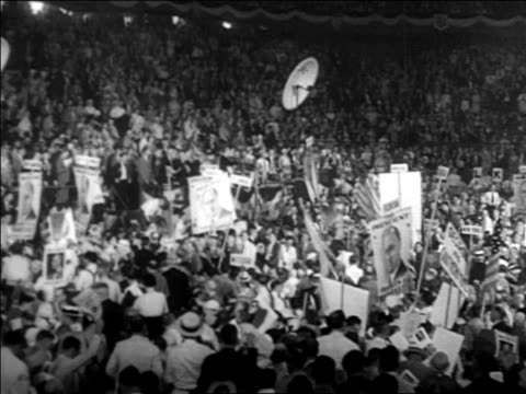 b/w 1932 crowd with fdr signs at democratic national convention - 1932 stock-videos und b-roll-filmmaterial