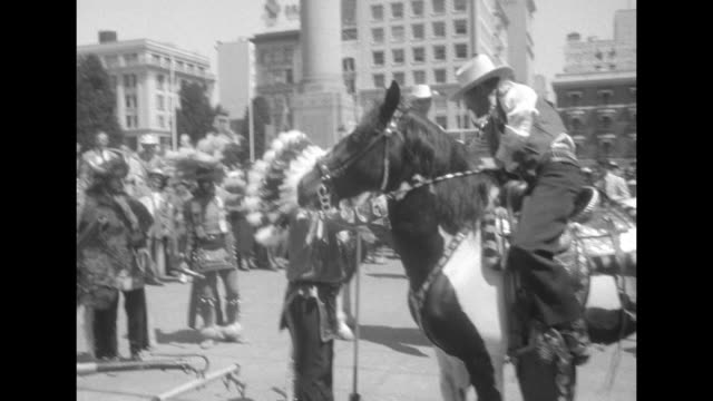vídeos de stock e filmes b-roll de crowd with ike and nixon signs watching performance with us mail stagecoach in center man walks across area as indians or players dressed as indians... - dança da guerra