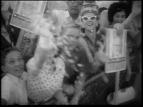 B/W 1964 crowd with signs cheering at airport for arrival of Barry Goldwater / Phoenix / newsreel