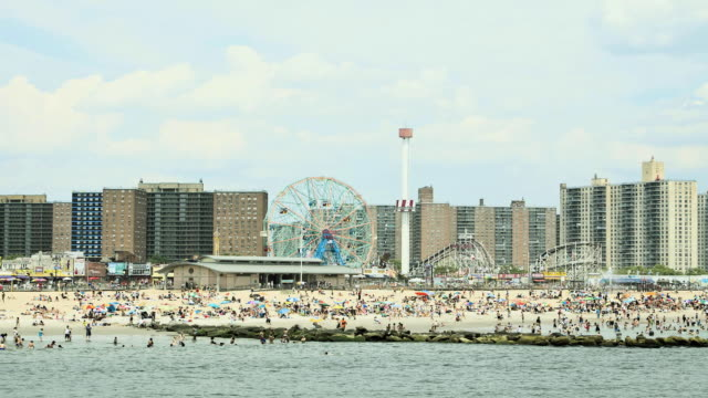 crowded beach at coney island, new york city, new york, usa - coney island stock videos and b-roll footage