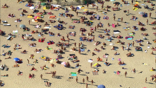 AERIAL, Crowded beach at d'Agde, Languedoc-Roussillon, France