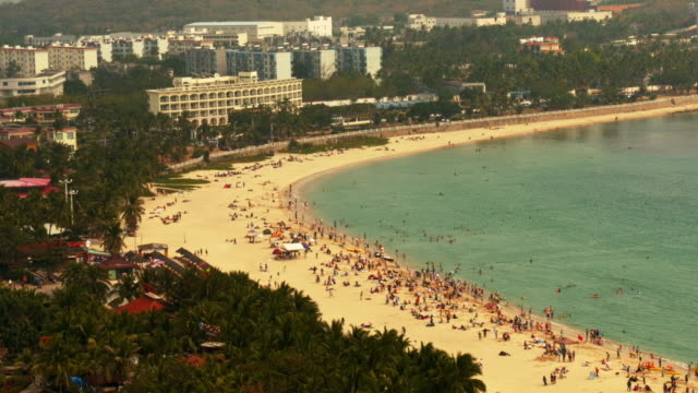 crowded beach in sanya, hainan province, china. view from above. wide shot. - spoonfilm stock-videos und b-roll-filmmaterial