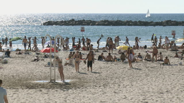 slo mo ws crowded beach / tel aviv, dan metropolitan, israel - tel aviv stock videos & royalty-free footage