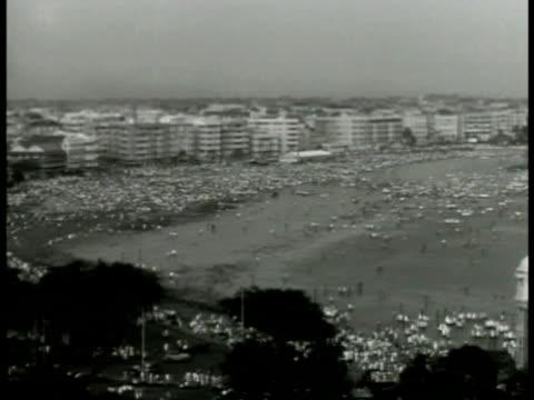 xha crowded beachfront w/ modern hotels bg vs very overcrowded streets people walking - newsreel stock videos & royalty-free footage