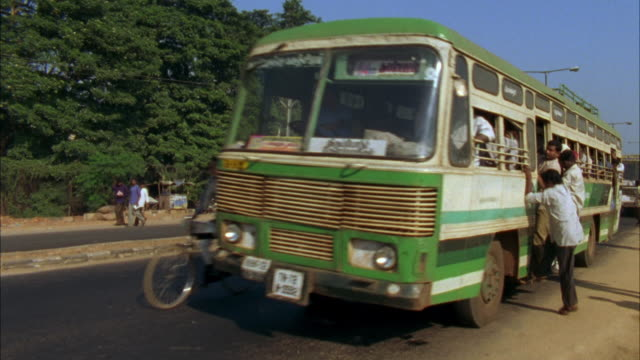ms, crowded bus driving on road, india - passenger stock videos & royalty-free footage