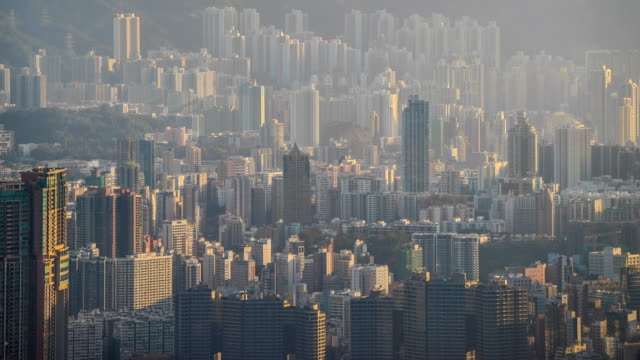 crowded city with sunlight, hong kong. - population explosion stock videos & royalty-free footage