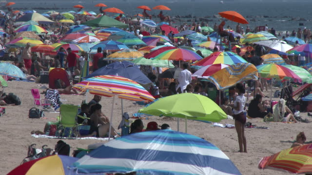 crowded coney island beach on a hot summer day - heatwave stock videos & royalty-free footage