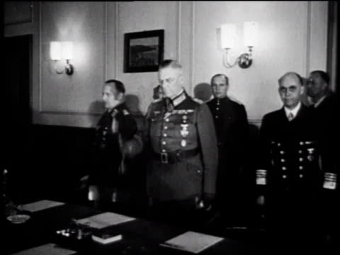ws crowded conference room / ws german officers entering room / ws crowded conference room / ms officer signing surrender documents / ms officer... - surrendering stock videos & royalty-free footage