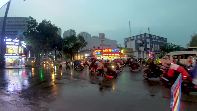 crowded crossroad on a rainy day - ho chi minh city stock videos & royalty-free footage