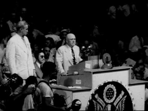 Crowded delegate floor w/ photo poster of Harry S Truman next to Missouri sign Convention Chairman Samuel Rayburn at podium introducing Missouri...