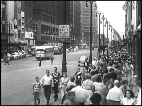 ws crowded downtown detroit street in 1952 / ws busy crosswalk / ws another crowded street montage downtown detroit in 1952 on january 01 1952 in... - michigan stock videos and b-roll footage
