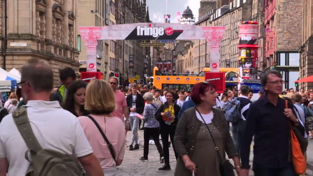 crowded edinburgh street scenes during the edinburgh fringe festival - road stock videos & royalty-free footage