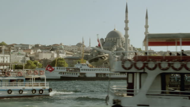 ws crowded harbor of ferries and ships near the  yeni camii mosque / istanbul, turkey - yeni cami mosque stock videos and b-roll footage