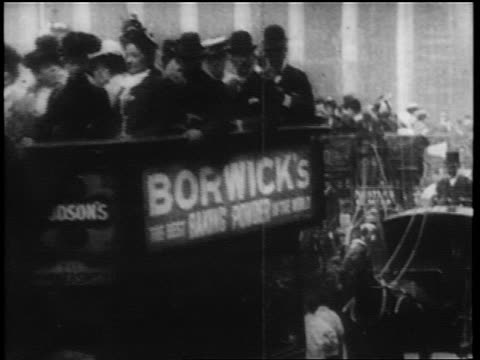 b/w 1902 crowded horse-drawn double decker buses on london city street - english culture stock videos & royalty-free footage