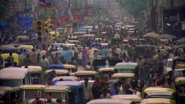 crowded indian street - rickshaw stock videos & royalty-free footage