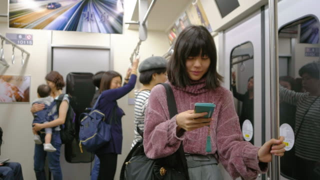 crowded japanese subway train - rail transportation stock videos & royalty-free footage