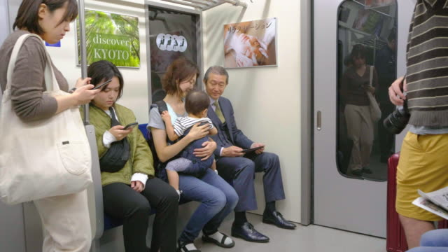crowded japanese subway train - social grace stock videos & royalty-free footage